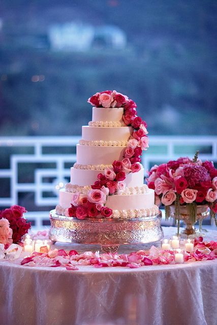 White cake with hot pink pale pink flowers. Hot pink would be my second choose; first being red.