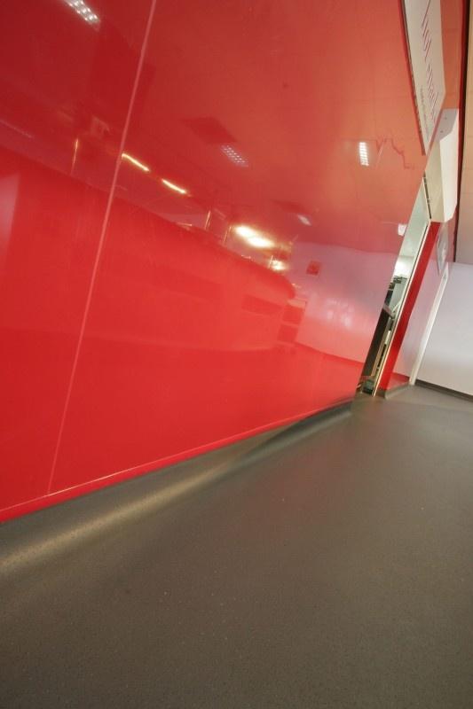 Jaguar choose Altro Whiterock Chameleon as a stunning feature wall.