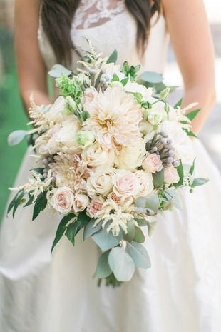 Overflowing wedding bouquet idea - lush pastel bouquet with roses, dahlias and greenery {Sasha Bohème Photography}