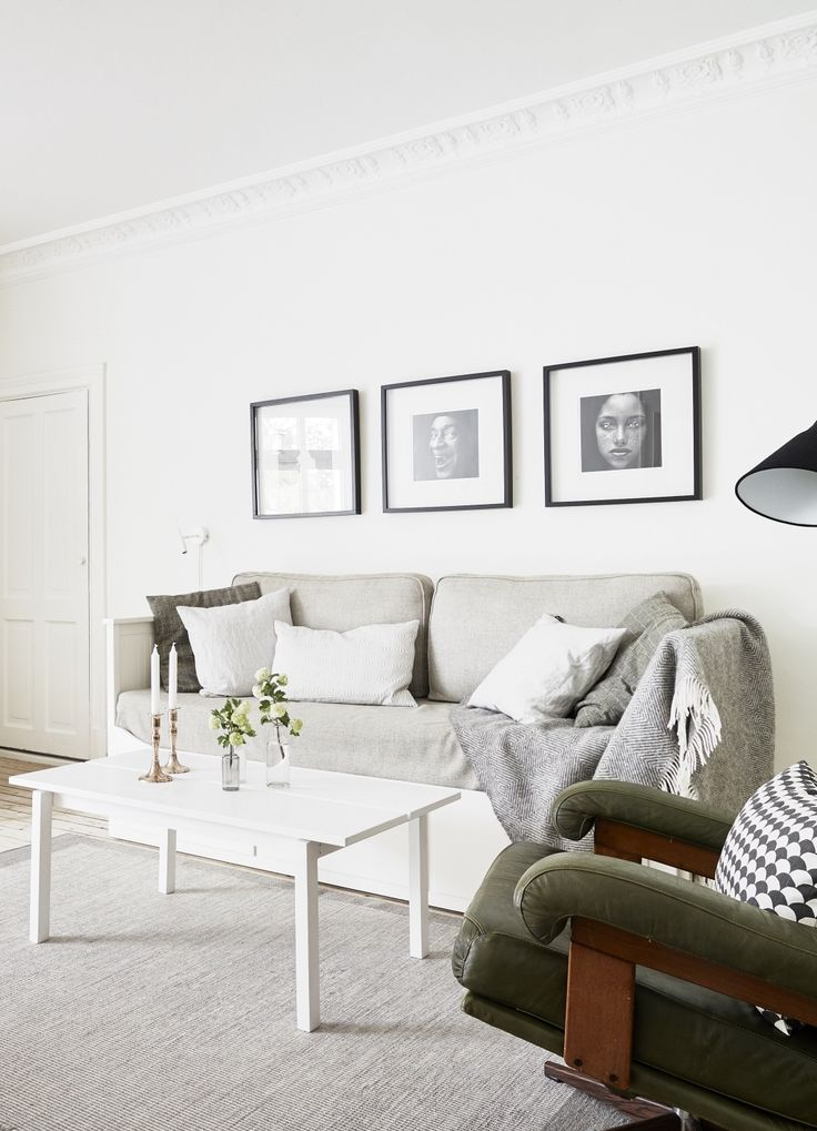 Great way to hang photographs in the living room: small