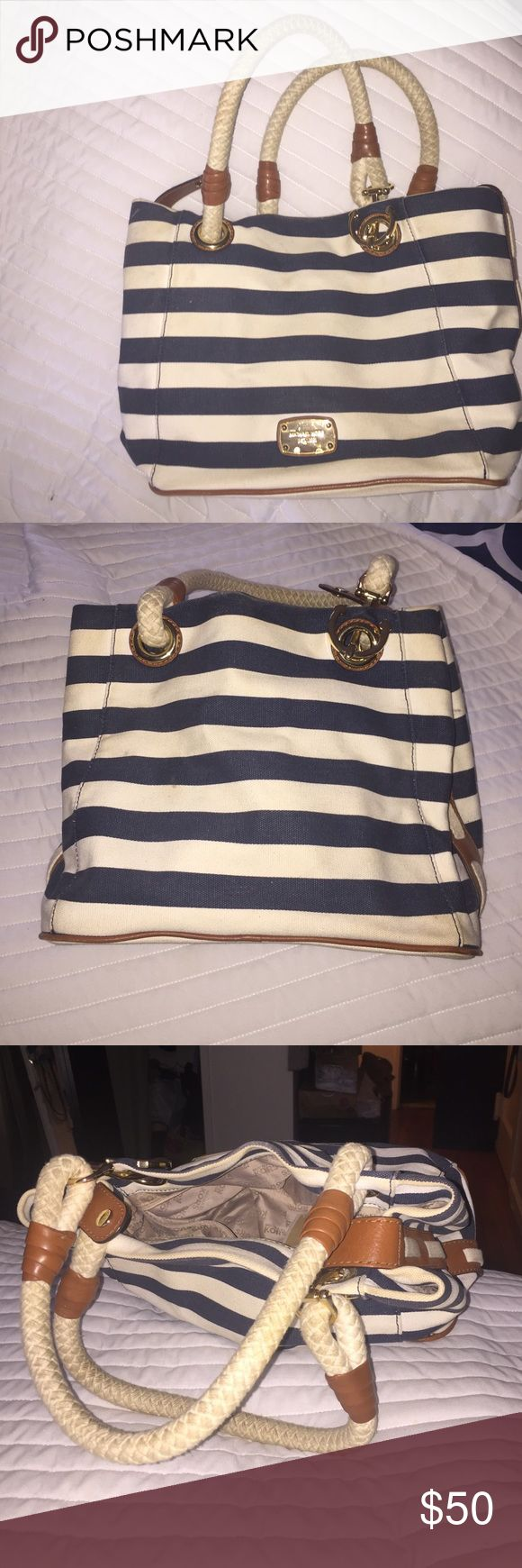 Micheal Kors shoulder bag. Has a lot of wear as white stripes are more cream now. Okay condition. I think a good dry cleaning would work well. But not really sure. KORS Michael Kors Bags Shoulder Bags