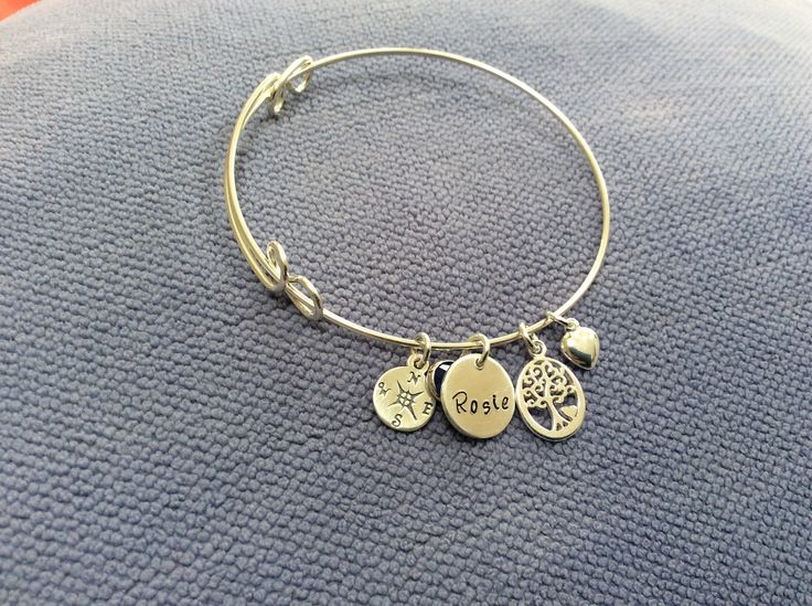Expandable silver bracelet with oval tree of life, personally hand stamped disc, compass and puff heart for a fun, travel loving friend!