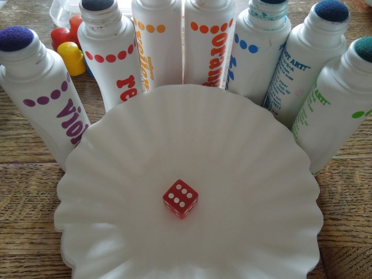 Use your dot art, dice and coffee filters for this easy Math game for preschoolers - coffee filter could then be sprayed with water to observe changes