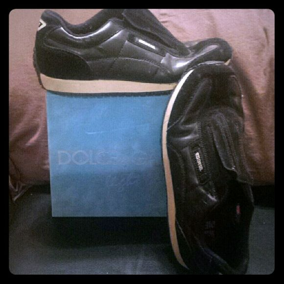 Authentic Diesel Shoes Black slip on Diesel Shoes, no laces. Worn but still has lots of life in them. Has a little bend in them from the crease of walking. Size 8. Please ask questions. Diesel Shoes