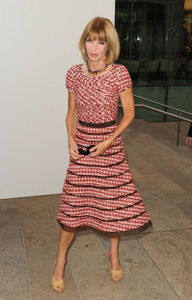 Anna looked super chic, as always, in her tweed dress, which she topped off with kitten heel sandals.