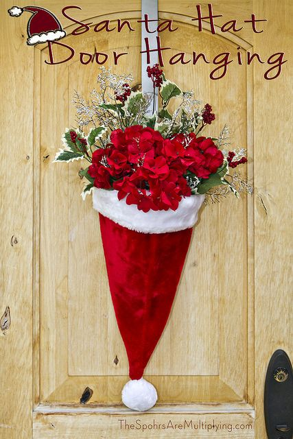 Instead of a traditional Christmas wreath, try this adorable alternative. Your family can easily get into the holiday spirit by taking part in this easy project. Simply glue a fitting basket inside the hat and fill it with goodies Santa will enjoy.  Get the tutorial at The Sphors are Multiplying.    - CountryLiving.com