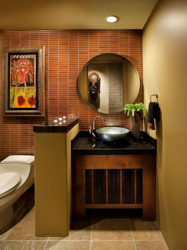 Vanity Upgrade - 12 Designer Bathrooms for Less on HGTV. Like the half wall between sink and tub
