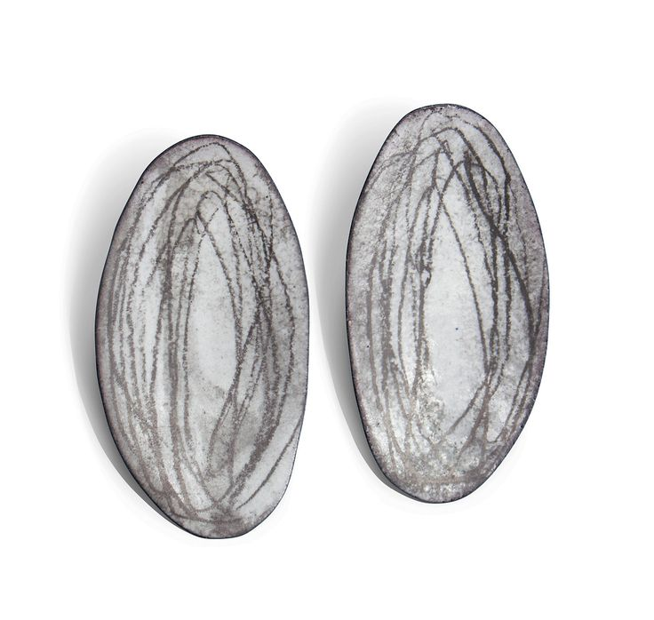 Oval Earrings by Christy Klug. Vitreous enamel and graphite.