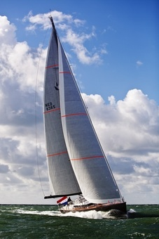 Full power thanks to North Sails, with her glorious carbon Hall Spars mast 31 meters above the water!