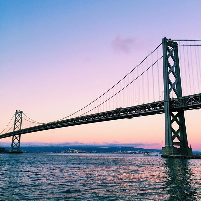 Stunning sunset tonight under the Bay Bridge on our way to dinner @packedparty #sanfrancisco #baybridge #pastelsky