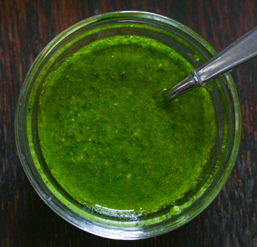 Cilantro Chimichurri | Eclectic Recipes (had this on roast chicken and potatoes and worked well. Also mixed it into chicken for tacos and that tasted even better. I bet it would taste awesome on beef or pork too)