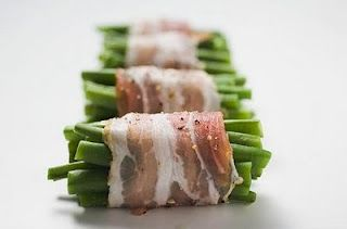 bacon wrapped green beans with butter, brown sugar, and garlic mixture poured over them, then baked. this sounds amazing!