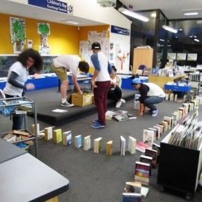 """Book Dominos:This program involves teens setting up a trail of book as dominos throughout their library. The New Zealand librarian points out that her teens really enjoyed having special """"behind-the-scenes"""" access to certain parts of the library. This program would also be easy to turn into a promotional tool for the library itself."""