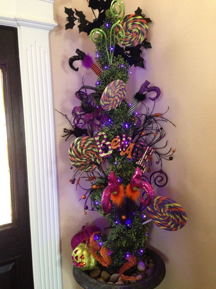 herere a couple of topiaries that flank the door that i decorated using some super cute raz halloween decorations from trendy tree so much fun - Raz Halloween Decorations