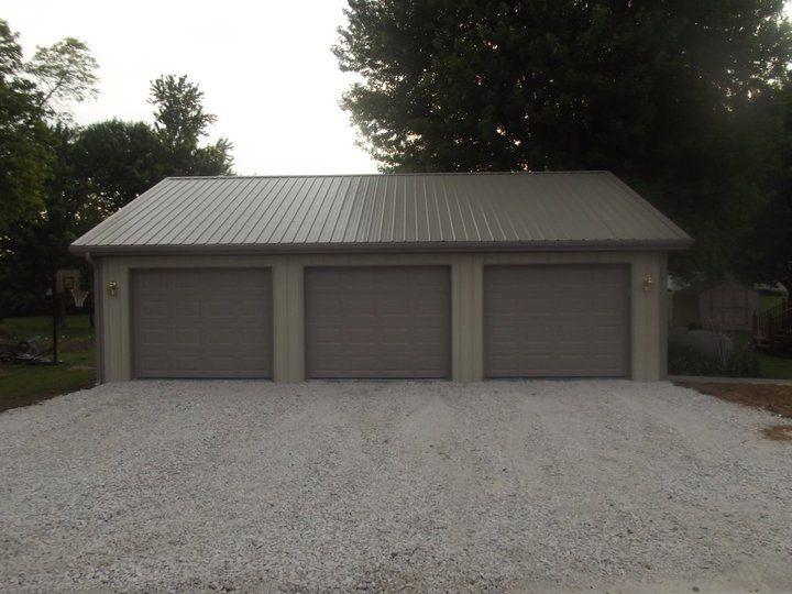 pole barn garages....seems way more functional than the huge beast that we have