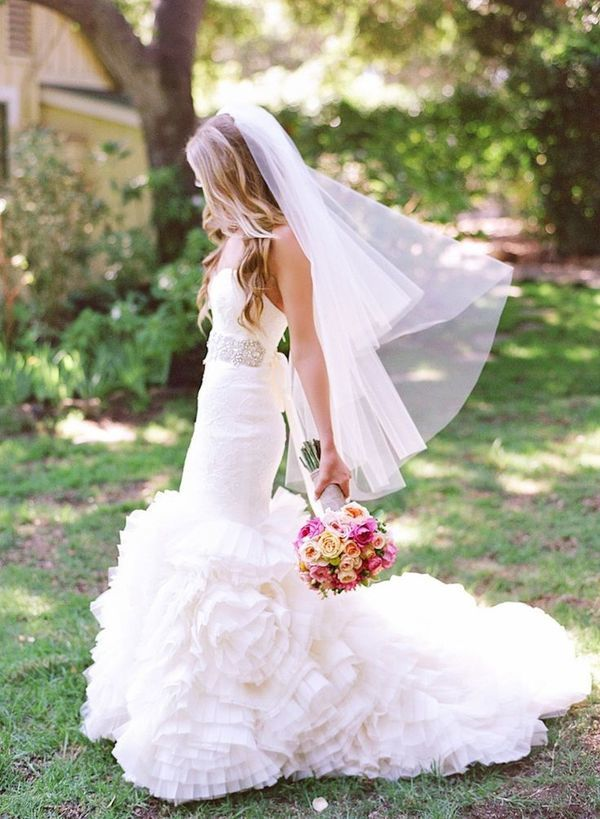 Bride with fingertip veil and trumpet gown. See more stunning veil trends here: http://www.mywedding.com/articles/9-veils-for-every-type-of-bride/