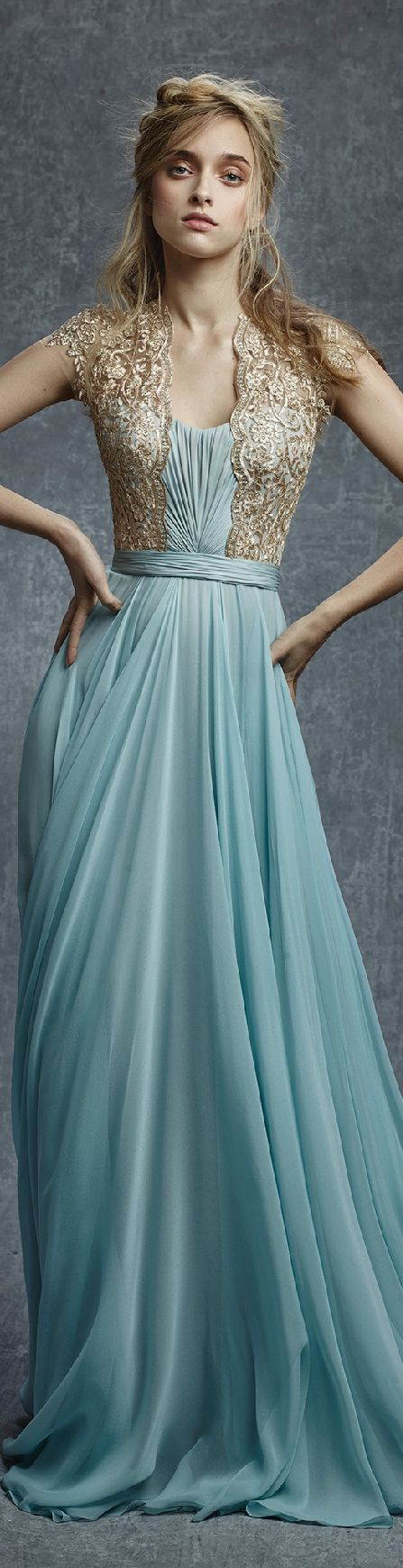 love the gold embroidery and the shaping. if the blue parts were ivory, would make a serious dress contender!
