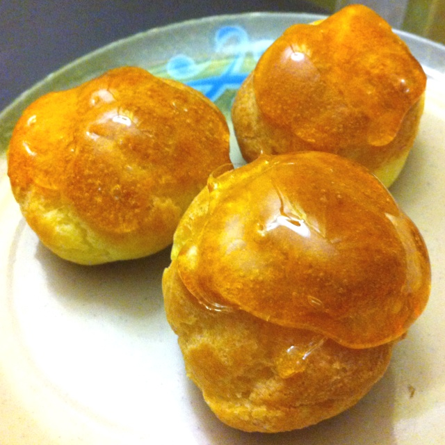 Creampuffs filled with pastry cream, topped with crunchy caramel..