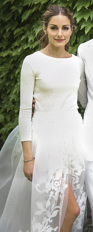 Olivia Palermo's wedding ensemble: sweater and shorts covered by a gorgeous tulle skirt.