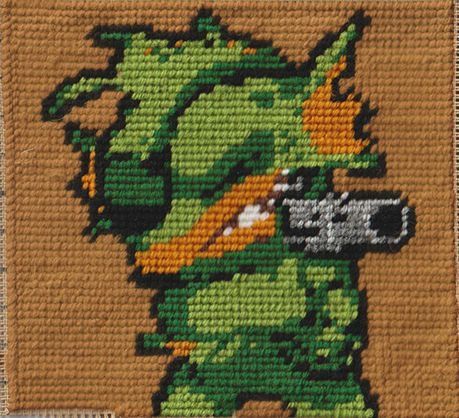 """""""Fish"""" from Nuclear Throne Medium: Cross-Stitching Time: 2w (elapsed) 10h (actual)  Part of a  blanket I'm working on"""