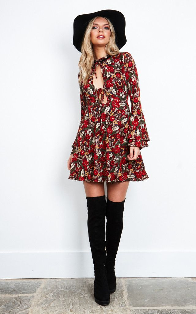 We're loving this dress here at SF HQ! The gorgeous delicate flower pattern and cut out front make for a stunning design. Add heels for a dressier look, flats for a daytime dress or knee high boots for a day to night ensemble.