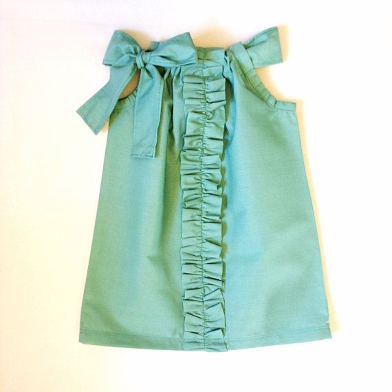 Mint green ruffle front pillowcase dress with fabric sash. By Sixpence Crafts.