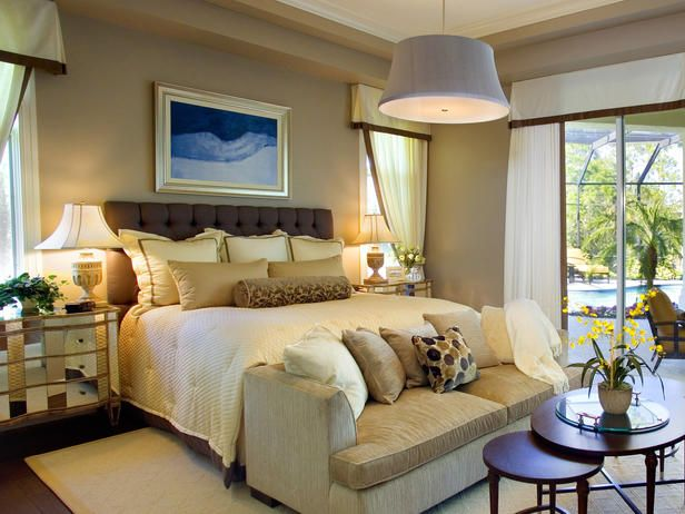 This bedroom is comfortable and light with its transitionally-modern look. Furnishings have clean, soft lines, the window treatments are breezy and the bedding, lighting and accessories are fresh and soothing. The colors are mainly neutral with hints of deeper golds and platinums, which are set off by a warm blue throughout.