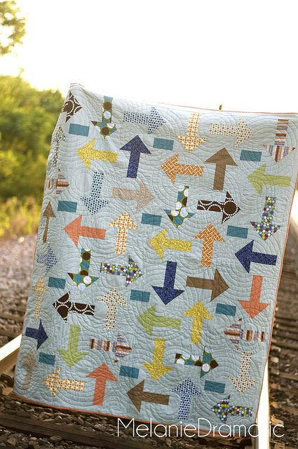 Project Linus idea- Use a rail fence block with outside strips the background fabric, and a flying geese block. -  arrow quilt | boy quilt