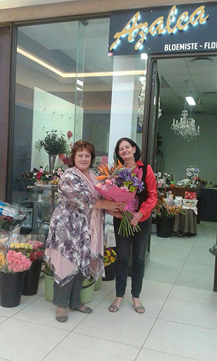 The Azalea Florist - Mother's Day Competition 2016 winner Amanda Bodenstein Meissenheimer collecting her bouquet from Marita Hattingh.