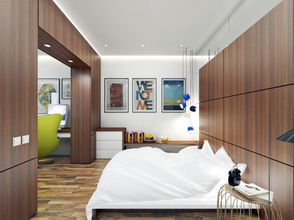 A wood paneled door frame separates the bedroom from the living room. By doing it this way, the room feel separate and private but the apartment still feels big. The use of mirrors around the bedframe is also a sleek way to imitate a bigger room.
