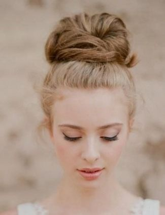 Master the romantic topknot with these 15 fresh styles for Valentines Day.