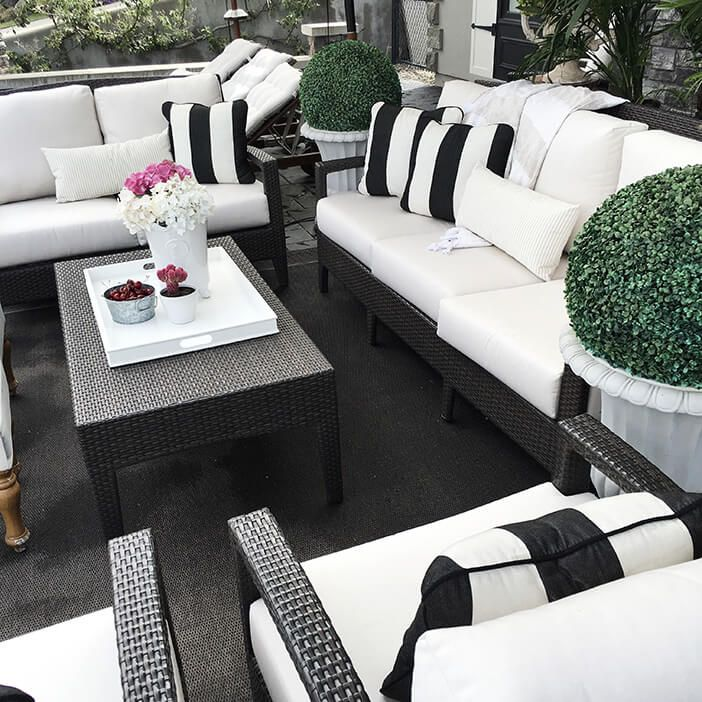 When people picture outdoor furniture, black doesn't usually come to mind. It seems like the black coloring would make the furniture too hot in the sun. But when placed in a shaded area, black outdoor furniture can be as stylish as it is functional. The photo above shows how perfect black furniture looks in a sleek, modern outdoor area.  If you're thinking of working with black outdoor furniture, the photo above shows the sleek option of white and black color schemes.