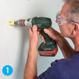 "Drill a 1"" hole centered on your desired location"