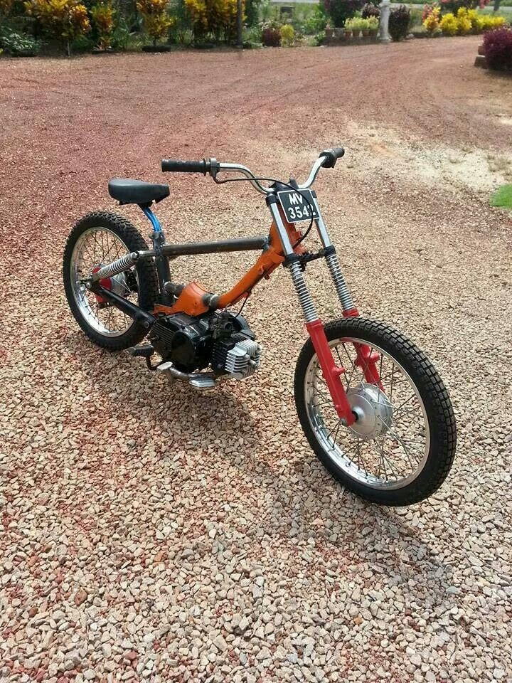 stripped down custom dirt track Honda Cub