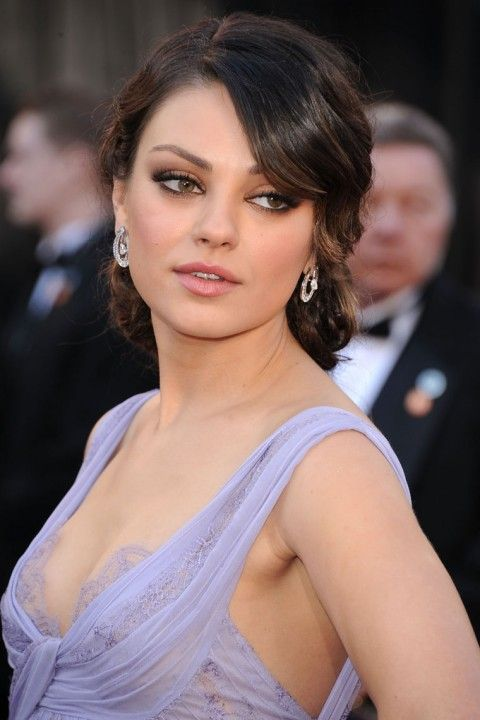 Mila Kunis, who I kind of hate for being so smoking hot. Eye makeup, hair color, and dress color = for the WN.