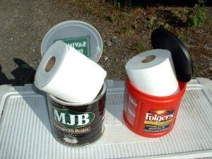 stick your toilet paper in an empty clean coffee can. It will keep it dry from rain and dew. Brilliant for camping