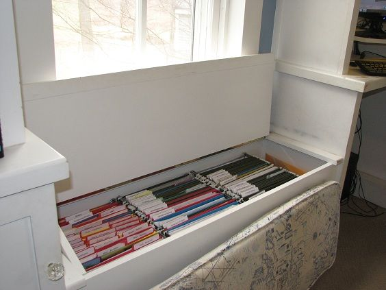 Family Filing System Located In A Window Seat.
