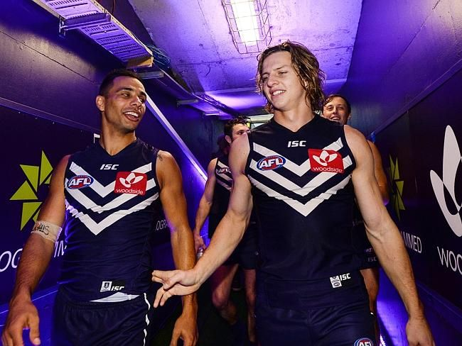 Nat Fyfe celebrates the win and his 100th match with Danyle Pearce. Photo by Daniel Carso