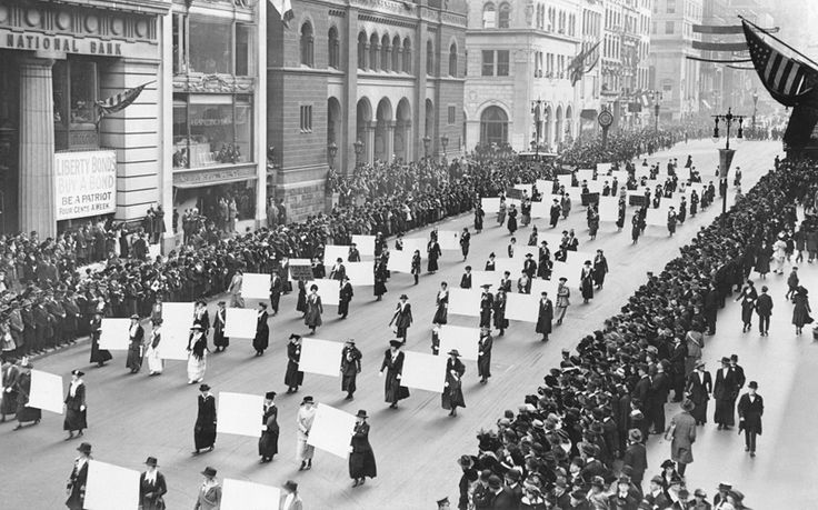 Women's suffragists parade in New York City in 1917, carrying placards with signatures of more than a million women.[1]