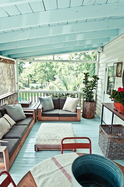 I love this porch, and it looks very similar to the structure of ours (ours is a little smaller, I think). We could definitely do something like this on ours, and paint it to brighten it up.