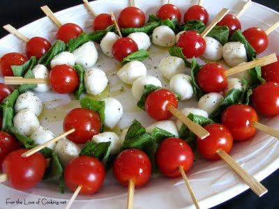 caprese skewers- I make these all the time for parties! and have them dip in Balsamic vinegar glaze! :-)