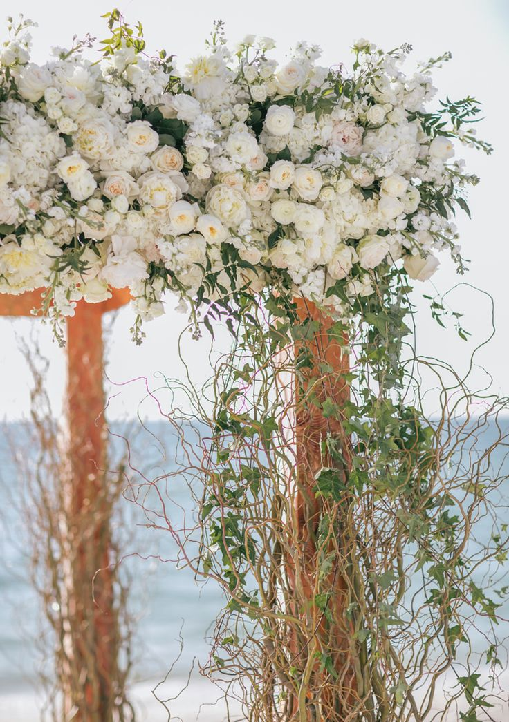 Luxury beach wedding floral arbor (Clane Gessel Photography)