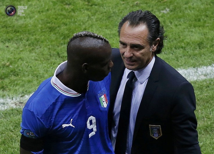 Italy's coach Prandelli talks to Balotelli after leaving the pitch during their Euro 2012 semi-final soccer match against Germany at the National Stadium in Warsaw. LEONHARD FOEGER/REUTERS