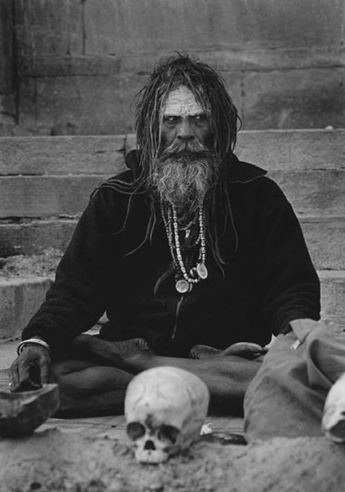 An Aghori man with a human skull - http://www.cultofweird.com/culture/aghori-cannibal-hindu-monks/