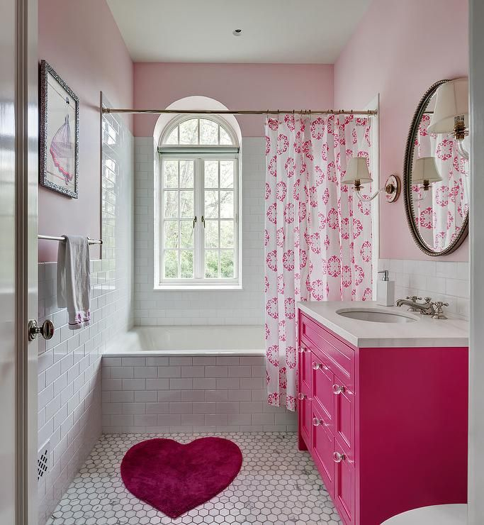 Lovely Pink Girl S Bathroom Features A Pink Heart Shaped Bath Rug Placed On White Marble Honeycomb Floor Girl Bathrooms Pink Bathroom Decor Hot Pink Bathrooms