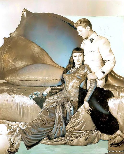 Maria Montez & Jean Pierre Aumont in The Siren of Atlantis 1949   Love the bed in the background