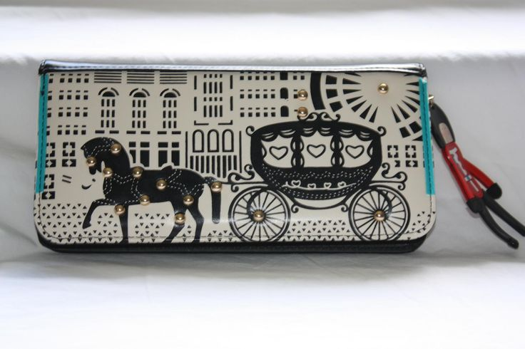 """The """"Royals About"""" Purse featuring the royal carriage and horse and a British Guard Zip Pull. A lovely purse that has the design on one side and plain black on the other and all your contents can be enclosed by the zip. Has many sections for cards and an enclosed zip pocket for your coins. Size: 21cm long, 11cm high, 3.5cm width. Material: PU Leather. AUD$29.95 plus post"""
