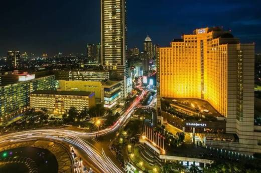 Only a long exposure can capture the pulse of Jakarta set against an indigo night sky.
