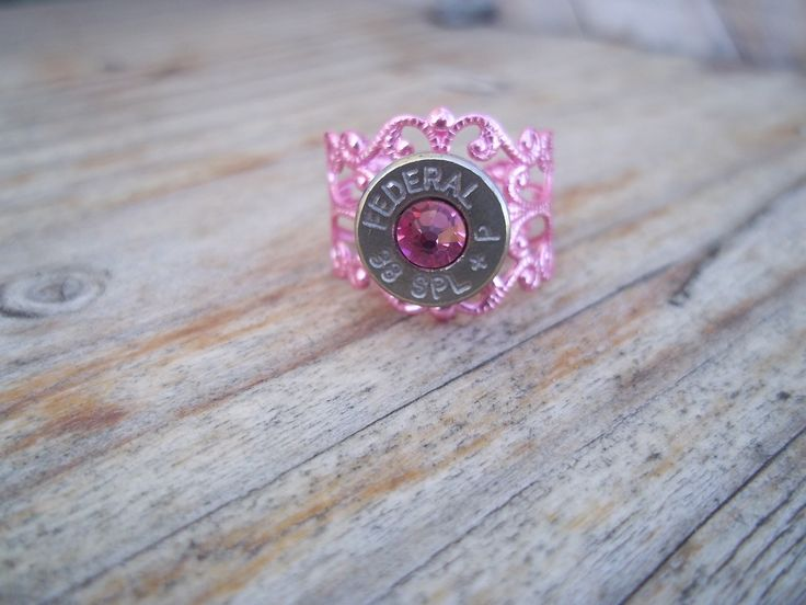 GWG 2013 Spring Bullet Ring with Swarovski Crystal - Pink  http://www.gwgclothing.com/shooting-accessories/spring-bullet-ring-1005.html