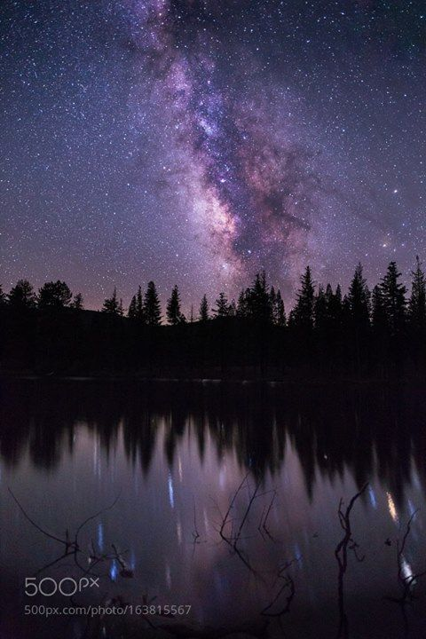 Milky Way over Reflection Lake My buddy Shaun and I went on a five-day road trip up through Oregon and we decided to stop at Lassen Volcanic National Park on the way back since neither of us had ever been. We talked about photographing the Milky Way if the skies were clear. We both fell asleep in the car but I woke up around 2AM after the moon had set. I stepped outside and immediately was in awe. I could see the core of the Milky Way with its dust lanes very clearly with my naked eye. I…